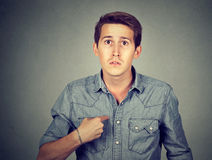 Guy pointing at himself you mean me? Royalty Free Stock Photo