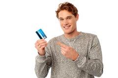 Guy pointing at his credit card Royalty Free Stock Photos