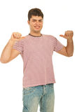 Guy with pointing thumbs to his t-shirt Royalty Free Stock Image