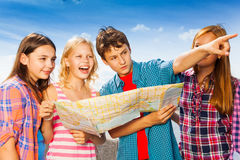 Guy points with other children standing together Royalty Free Stock Images