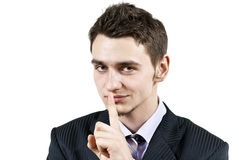 Guy points to remain silent. Guy points the finger to remain silent Stock Photography