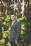 Guy poses in forest Stock Images