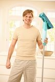 Guy posing with mop Royalty Free Stock Photo