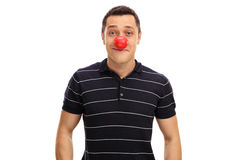Guy posing with a red clown nose Royalty Free Stock Photos