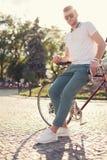 Guy posing with vintage race bike. Stylish guy posing with vintage race bike Stock Image