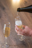 Guy pours in a glass champagne Stock Image