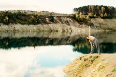 Guy practices asanas on yoga in harmony with nature Stock Photography