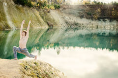 Guy practices asanas on yoga in harmony with nature Royalty Free Stock Photo