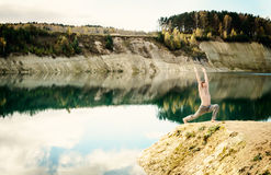 Guy practices asanas on yoga in harmony with nature Royalty Free Stock Photos