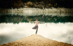 Guy practices asanas on yoga in harmony with nature Royalty Free Stock Photography
