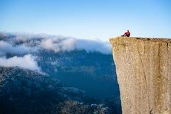 Guy on the Preikestolen rock, Norway Stock Image