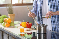 Guy preparing healthy food at home royalty free stock image