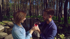 Guy present a ring. engaged outdoors. stock footage