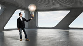 Guy presenting bright idea Stock Photo