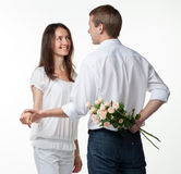 Guy presenting flowers to girfriend Royalty Free Stock Image