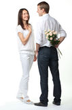 Guy presenting flowers to young lady Royalty Free Stock Photo
