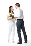 Guy presenting flowers to young lady Stock Images