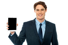 Guy presenting newly launched tablet device Stock Image