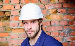 Guy protective helmet bearded handsome builder. Builder helmet construction site sit relaxing lean brick wall. Take. Minute to relax. Man take break working day stock photography