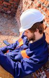 Guy protective helmet bearded handsome builder. Take minute to relax. Man take break working day at construction site royalty free stock images