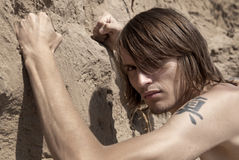 Guy punches wall of sand royalty free stock photo