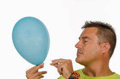 A guy puncturing a balloon Royalty Free Stock Photo