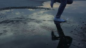 Guy purposefully running through puddles to his dreams, ready overcome adversity. Stock footage stock video