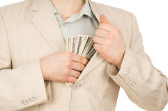 Guy puts the money in his pocket Royalty Free Stock Image