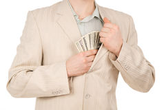 Guy puts the money in his pocket Royalty Free Stock Photo