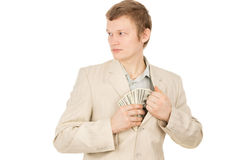 Guy puts the money in his pocket and looks around Royalty Free Stock Photo