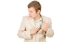 Guy puts the money in his pocket and looks around Stock Photo