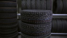 The guy puts the tires on top of each other stock footage