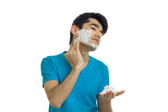 Guy putting a face before shaving foam Stock Photos