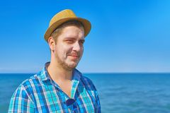 Guy putting on sun cream on the face. stock image