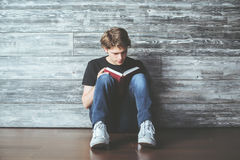 Guy reading book Royalty Free Stock Image