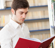 Guy reading a book Royalty Free Stock Photo