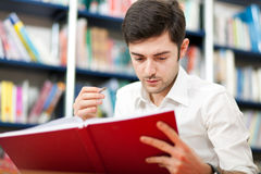 Guy reading a book Royalty Free Stock Image