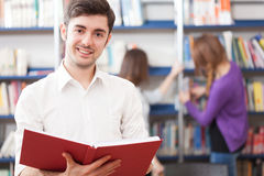 Guy reading a book Stock Image