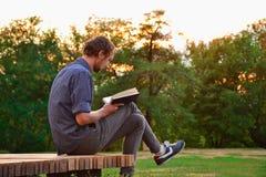 Guy reading book Royalty Free Stock Photos