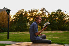 Guy reading book Stock Photo