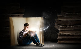 Guy reading book Stock Photography