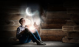 Guy reading book Stock Images