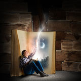 Guy reading book Stock Image