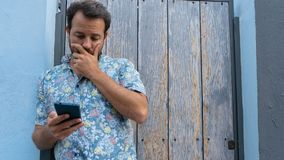 Free Guy Reading News Upset With Facial Frustration And Concerned. Modern Bearded Man Nervous Looking Smart Phone Watching Lottery And Stock Images - 160755574