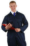 A guy with a  red clipboard in overalls Stock Photography