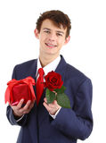 A guy with a red rose and a present Royalty Free Stock Photography