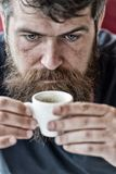 Guy relaxing with espresso coffee. Coffee break concept. Hipster drinking coffee close up. Caffeine recharge. Man with royalty free stock photos