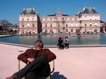 A guy relaxing in Luxembourg garden Royalty Free Stock Images