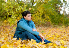Guy relaxing in park, autumn outdoor. Stock Photography