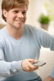 Guy with remote control Stock Images